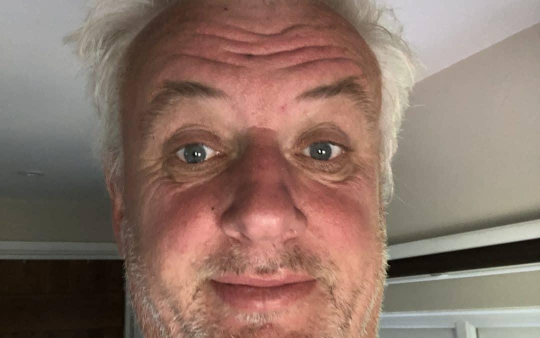 Dave Garbett raising money by cutting in hair